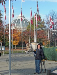 Posing on the CNE grounds under the Canadian flags